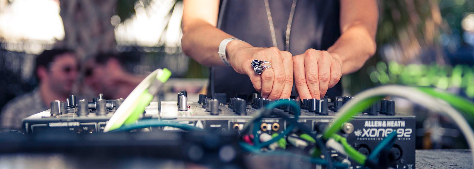 DJ mixing at a festival